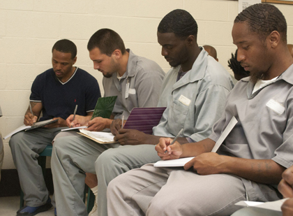 Missouri Eastern Correctional Center (MECC) inmates enrolled in ARCHS' Second Chance Act Mentoring Program write out their thoughts and goals during a recent journaling class.