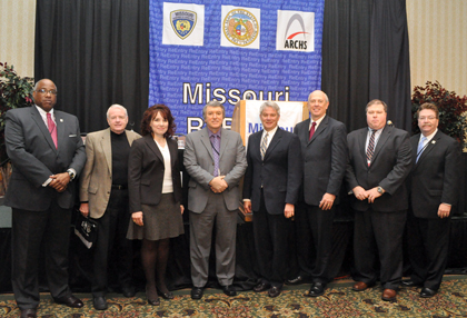 ARCHS' Chief Executive Officer Wendell E. Kimbrough with Department Directors for the State of Missouri at the 2010 Missouri Reentry Conference. From left are, Kimbrough, Keith Schafer (Department of Mental Health), Alana Barragan-Scott (Department of Revenue), George Lombardi (Department of Corrections), Gary Waint (Office of the State Courts Administrator), David Kerr (Department of Economic Development), Brian Kinkade (Department of Social Services) and Bill Dent (Manager for Family and Community Trust).